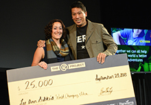 Bruce Poon Tip presentes The G Project winner Lee-Ann Gibbs with $25,000 cheque